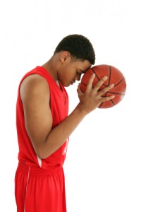 basketball-player-meditating-with-ball-at-head-200x300
